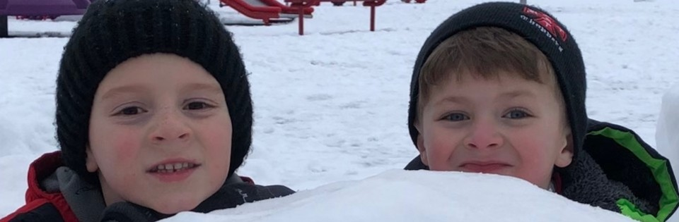 Boys playing in snow