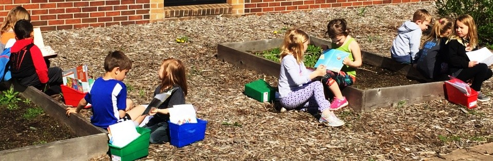 Sunnyside students reading on playground